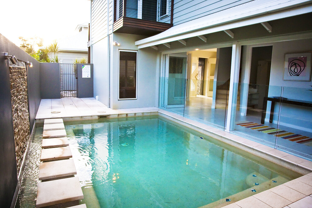 Dunk Island Holidays: Mission Beach Absolute Beachfront Holiday Homes • 2/24